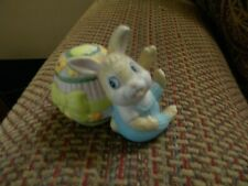 Ceramic Boy Bunny in Blue Overalls with Easter Egg Behind him- about 2 in. tall