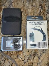 Casio EXILIM ZOOM EX-Z750 7.2MP Digital Camera &  Case & Car Battery Charger