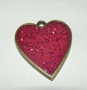 Lovely hand made resin red heart pendant in metal bezel