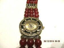 Heidi Daus Quartz Yellow Gold Tone Crystal and Burgundy Bead Wrist Watch