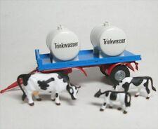 Remorque avec Réservoirs et 3 Vaches