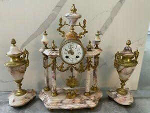 Antique French marble mantel clock with urns