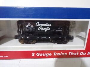 M.T.H. CANADIAN PACIFIC ORE CAR WITH LOAD. ROAD #377134