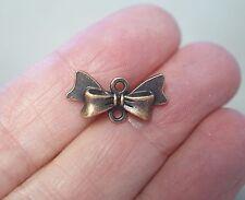 10 BOW/ARC Noeud Bijoux Connecteurs, charms - 20 mm, métal Antique Cuivre Couleur