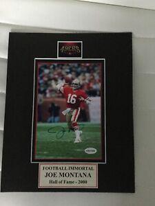 Joe Montana signed 5x7 photo in a 8x10 Matt..... Certified