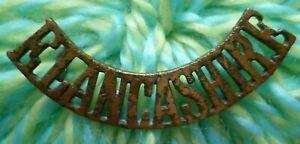 E LANCASH Shoulder Title East LANCASHIRE Title Badge BRASS Antique ORIGINAL