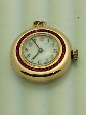 14 kt. yellow gold ladies pendant watch. Longines. circle of Rubies. antique.