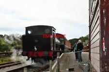 PHOTO  2010  0-4-0ST NO.22  AT BOLTON ABBEY RAILWAY STATION A TRAIN HAS JUST ARR