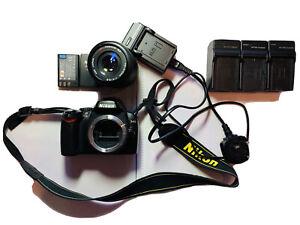 Nikon D40 camera, 2 Batteries, 4 Chargers, 1 Tokina 70-210mm Lens