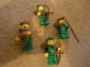 Lot 32: Lego Minifigures - Forestmen x 4 with weapons.