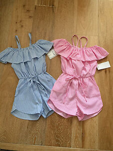 girls play suit with frilly neck