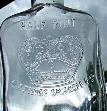 St. Pierre Smirnoff's, half pint, flask, liquor bottle(empty) 1960's Emb. Crown