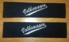 VW seat belt pads with embroidered Volkswagen swoosh logo.