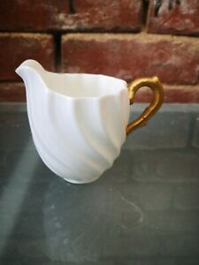 ANTIQUE OFF WHITE AND GOLD COALPORT RIBBED JUG 9CMS HIGH