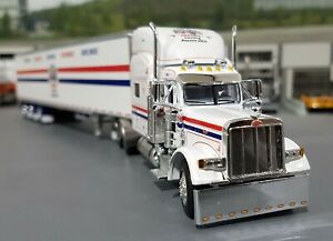 1/64 DCP PETERBILT 379 DISCOUNT FREIGHT EXPRESS WITH TRI AXLE TRAILER NEW