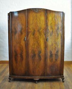 Antique vintage walnut bow front triple door wardrobe