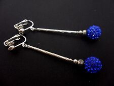 A PAIR OF LONG DANGLY BLUE SHAMBALLA STYLE  SILVER PLATED CLIP ON EARRINGS.