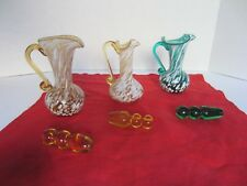 3 Vintage Multi-Colored Hand Blown Glass Pitchers w/ Fluted Rims & Stoppers