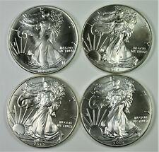 1992, 2013, 2014, 2015 Silver Eagle Coins