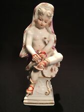 Meissen porcelain figure of a skater, child in pink robe on pedestal base