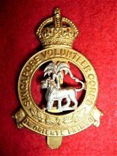 Singapore Volunteer Corps bi-metal Cap Badge circa 1928-42,  Die-stamped