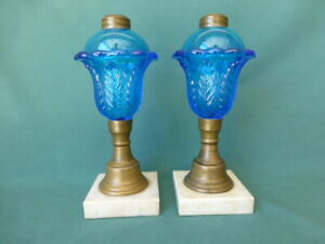 Two Antique Blue Glass Acanthus Leaf Oil Lamps with Marble Bases