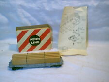 Vintage Penn Line 40' flat car with load.