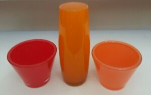 2 CRATE AND BARREL CANDLE HOLDERS RED AND ORANGE WITH A CYLINDER VASE ORANGE