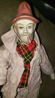 "Vintage Porcelain SAD HOBO CLOWN DOLL w/ pipe and bag approx. 14"" tall"