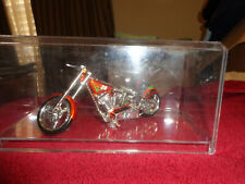 model chopper in a plastic display case the letters mbna on the seat cover.