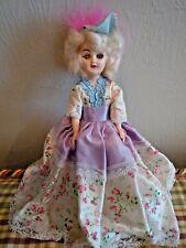 "Plastic 7 1/2"" doll from 1970's - original flowery dress - molded eyelashes"