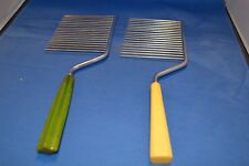 Lot of 2 Vintage bakelite cake cutters
