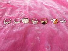 LOT OF 7 STERLING SILVER AND CUBIC ZARCONIA COCKTAIL RINGS VARYING SIZES