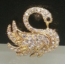 Lovely sparkling swan brooch in gold colour with crystal rhinestones