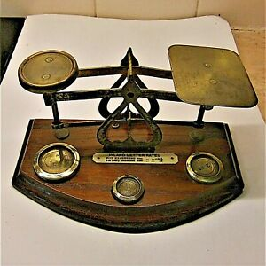 ANTIQUE PAIR OF ROYAL MAIL POSTAL SCALES WITH WEIGHTS.