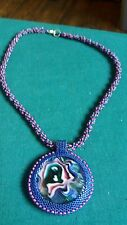 Handmade with love - Spiral beaded necklace with glass cabochon pendant