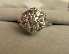 WHITE GOLD ONE CARAT 7 STONE RAISED CLUSTER....CLEAR DIAMONDS...SIZE 6 1/2 TO 7
