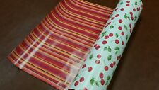 Half ream 24 inch wide cherries and Stripes reversible gift wrap 417 feet