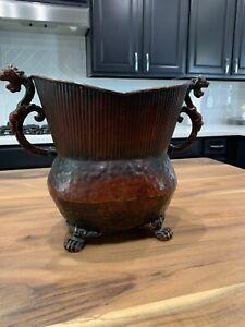 decorative rustic gargoyle footed vase