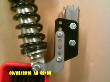 Adjustable  coil-over mounting brackets. Offers 10X more adjustment !!!