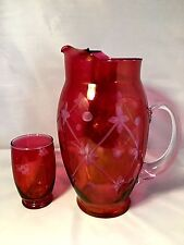 Hand blown floral etched cranberry glass Pitcher with one maching Glass.