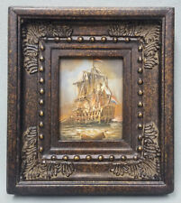 Miniature oil painting of colonial Warship in action with ornate frame