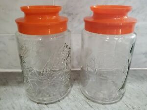 Vintage Anchor Hocking 2 Glass Canisters  Jars Daffodils & Bridge  Orange Lids