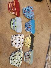 Grovia, Bum Genious Flip, Miosolo (nip) and Nikis. Cloth diaper covers.