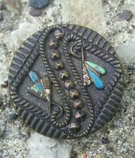 Antique painted ornate metal button.