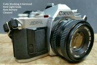 Canon AV1 WORKING CLA & NEW SEALS 35mm SLR Film Camera & FD 50mm 1:1.8 Lens