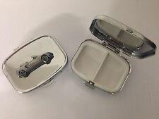 Honda Beat ref95 pewter effect car emblem on a silver metal pill box