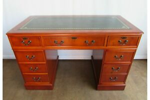 Antique Style Reproduction Captains Twin Pedestal Desk With Green Leather Top.