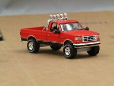 dcp/greenlight CUSTOM lifted 1992 Ford F150 red 1/64.