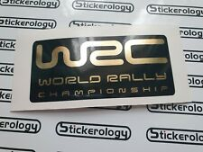 2 X WRC WORLD RALLY CHAMPIONSHIP STICKERS MIRROR GOLD AND BLACK